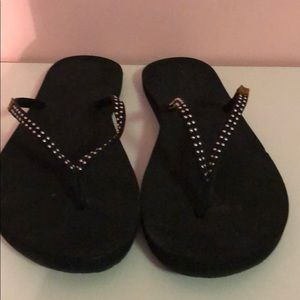 NWOT Reef black flip flops with silver size 9